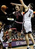 Chicago Bulls forward Andres Nocioni, of Argentina, left, goes up for a basket against the defense of Milwaukee Bucks center Andrew Bogut, of Australi