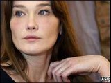 Carla Bruni says 'may adopt' baby